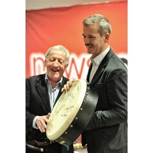 The Chieftains' Paddy Maloney presents Cmdr Chris Hadfield with a signed bodhrán, courtesy of Waltons Music)